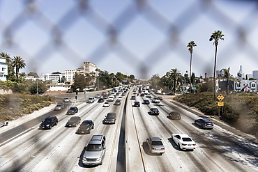 Cars driving along sunny freeway, Los Angeles, California, USA
