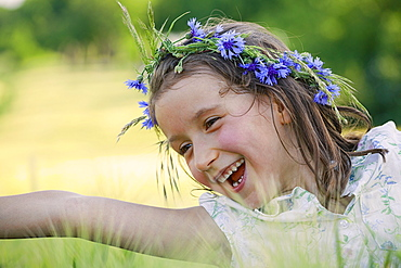 Happy, carefree girl with flowers in hair