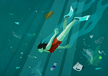 Woman swimming underwater in sea among pollution
