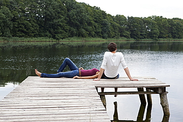 Young couple relaxing on pier