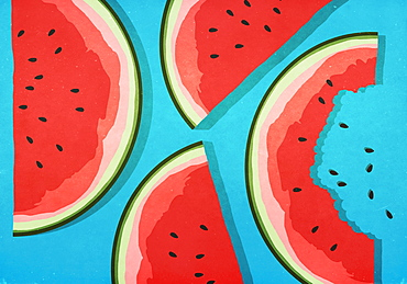 Juicy watermelon slices on blue background