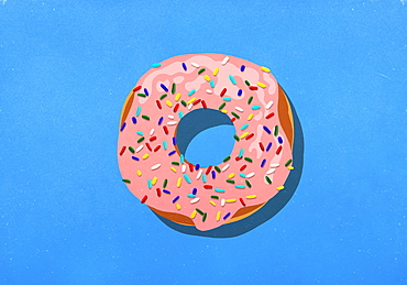 Pink donut with sprinkles on blue background