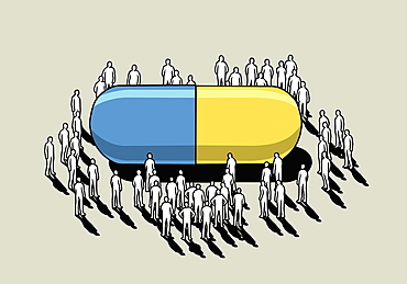 Crowd surrounding large pharmaceutical capsule