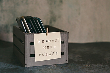 Mobile phone holder with sign