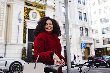 Happy young woman on urban street