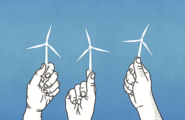 Hands holding tiny wind turbines