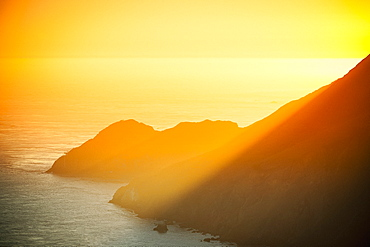 Golden sunset over ocean cliffs, San Francisco, California