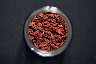 View from above goji berries in spice jar