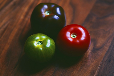 Close up red, green and purple tomatoes