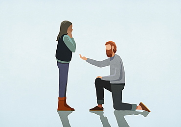 Man kneeling, proposing marriage to woman