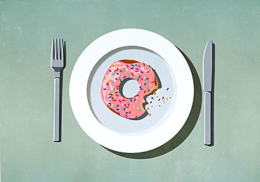 Missing bite from pink donut with sprinkles on plate