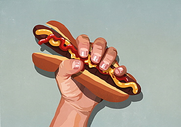Mans hand squeezing hot dog