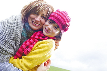 Portrait happy mother and daughter hugging