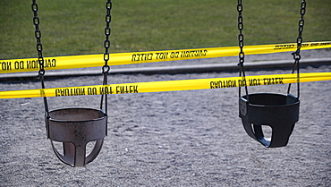 Playground swings taped off during COVID-19 pandemic