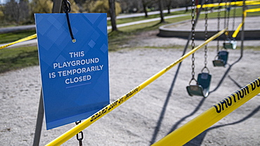 Playground closed sign and tape during COVID-19 pandemic