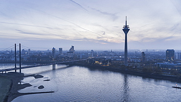 Rhine Tower and Rhine River at dusk, Duesseldorf, North Rhine-Westphalia, Germany