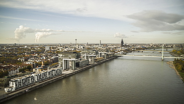 Sunny Rhine River and Cologne cityscape, Germany