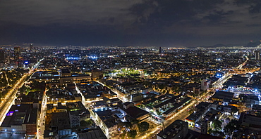 Aerial view Mexico City cityscape at night, Mexico