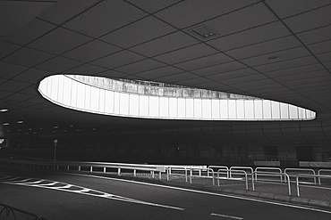 Round opening over abandoned airport road, Tokyo, Japan