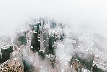 Aerial view highrise buildings in fog, Chicago, Illinois, USA