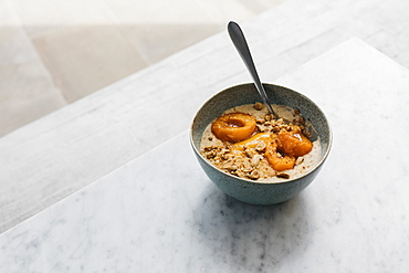 Roasted apricot porridge with almond milk and nuts