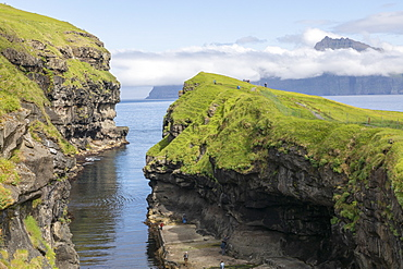 Moss covered rock formations, Faroe Islands