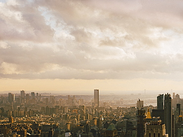 Clouds over sunny cityscape, New York City, New York, USA