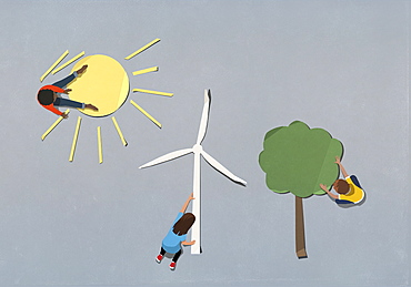 Kids arranging environment and wind turbine paper symbols