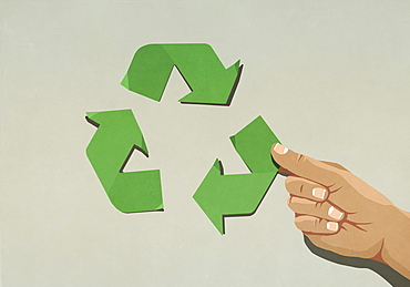 Hand assembling green recycling symbol arrows
