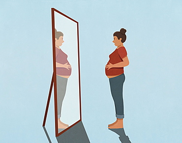 Pregnant young woman looking at reflection in mirror