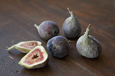 Close-up of figs on wooden table
