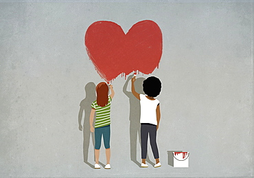 Multiethnic girls painting red heart on wall