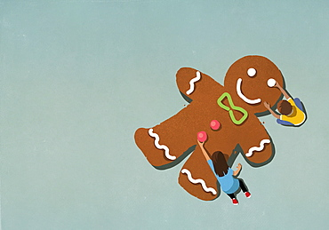 Boy and girl assembling gingerbread man