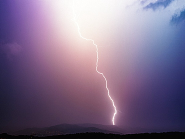 Lightning bolt in majestic stormy sky, Tanneron, French Riviera, France
