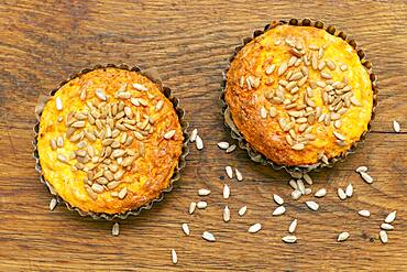 Close up seeded muffins on wood surface