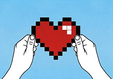 Hands holding pixelated heart