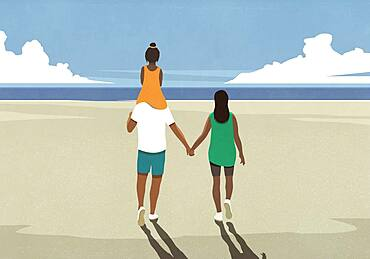 Family holding hands walking on sunny tranquil ocean beach