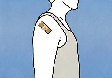 Man with Covid vaccine bandage on arm