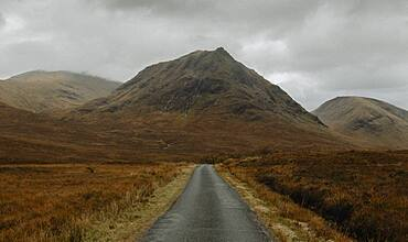 Road leading to rugged remote mountains, Glen Etive, Scotland