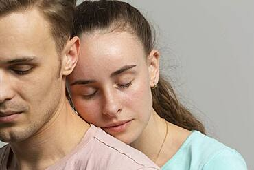 Close up serene tender young couple with eyes closed