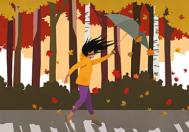 Wind blowing woman with umbrella in autumn park