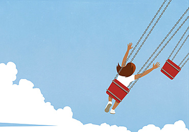 Carefree girl riding chain swing ride against blue sky