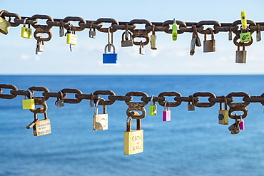 Chains and padlocks against sea