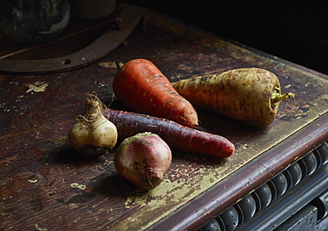 Root vegetables on wooden table