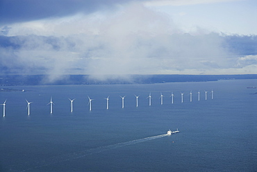 A row of wind turbines in the sea