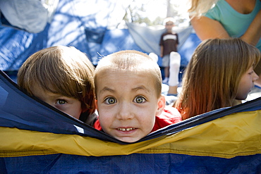 A group of children in a tent