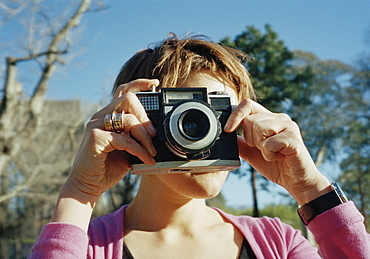 A woman taking a photograph