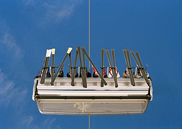 Low angle view of skiers sitting on a ski lift
