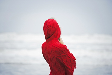 Rear view of a woman wearing a red hooded top