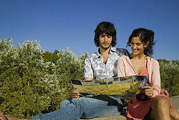 A young couple looking at a tourist map